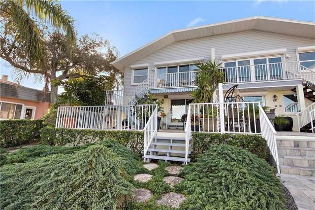 246 Dolphin Point, Clearwater Beach, FL 33767 (MLS #U8053963) :: Delgado Home Team at Keller Williams