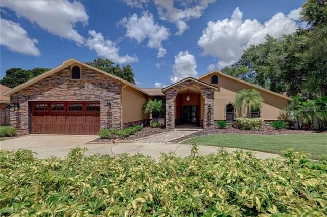 12289 Oaks Lane, Seminole, FL 33772 (MLS #U8056822) :: Mark and Joni Coulter   Better Homes and Gardens
