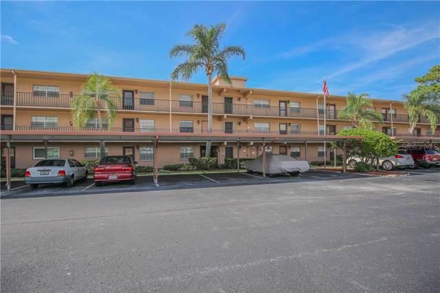 1370 Heather Ridge Boulevard #105, Dunedin, FL 34698 (MLS #U8062584) :: Griffin Group