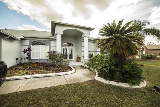 8720 Cypress Lakes Boulevard, New Port Richey, FL 34653 (MLS #U8065375) :: Griffin Group