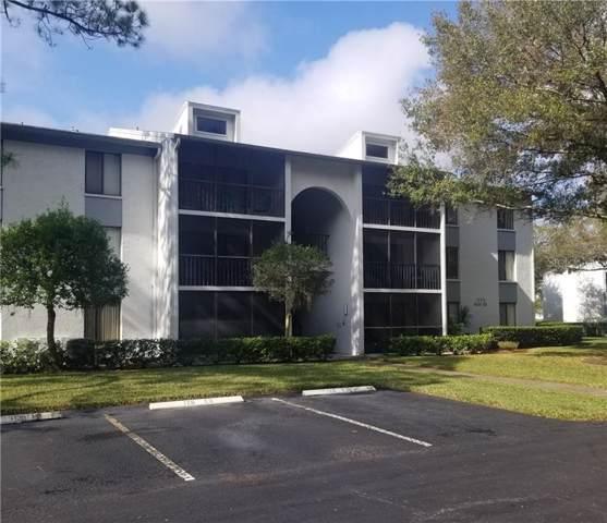 1353 Pine Ridge Circle E G1, Tarpon Springs, FL 34688 (MLS #U8067299) :: The Duncan Duo Team