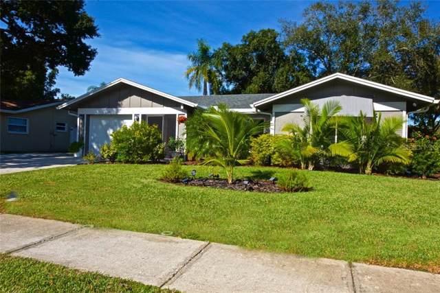 2121 Portside Passage, Palm Harbor, FL 34685 (MLS #U8068639) :: RE/MAX CHAMPIONS