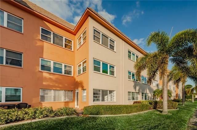 8 Glencoe Place #202, Dunedin, FL 34698 (MLS #U8086170) :: Premium Properties Real Estate Services