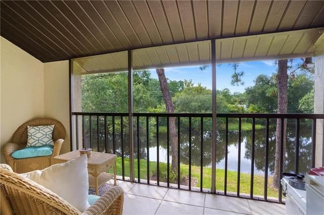 1200 Tarpon Woods Boulevard N7, Palm Harbor, FL 34685 (MLS #U8093615) :: Griffin Group