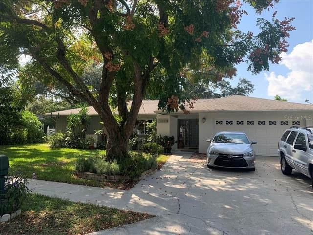 1039 Spanish Oaks Boulevard, Palm Harbor, FL 34683 (MLS #U8101952) :: Sarasota Property Group at NextHome Excellence
