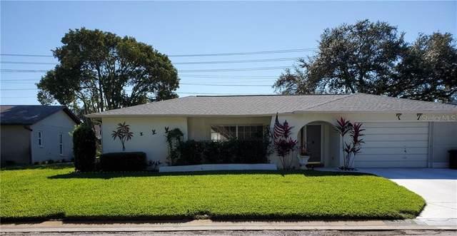 8320 Winding Wood Drive, Port Richey, FL 34668 (MLS #U8106223) :: The Kardosh Team