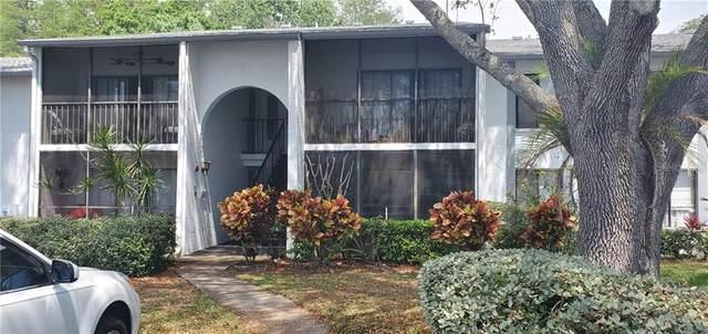 1258 Pine Ridge Circle W H1, Tarpon Springs, FL 34688 (MLS #U8119246) :: Coldwell Banker Vanguard Realty