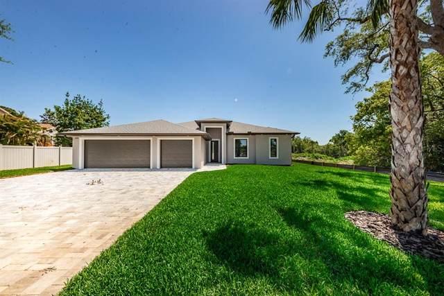 10086 Hilltop Drive, New Port Richey, FL 34654 (MLS #U8120315) :: The Light Team