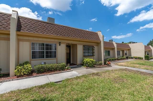 11400 Carriage Hill Drive #2, Port Richey, FL 34668 (MLS #U8122949) :: The Brenda Wade Team