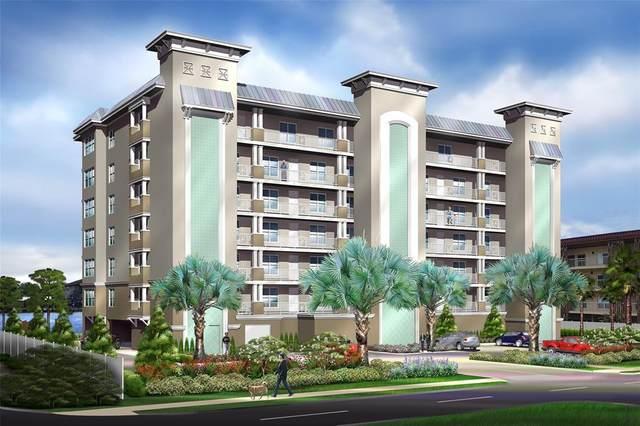 125 Island Way #405, Clearwater, FL 33767 (MLS #U8129926) :: Sarasota Home Specialists