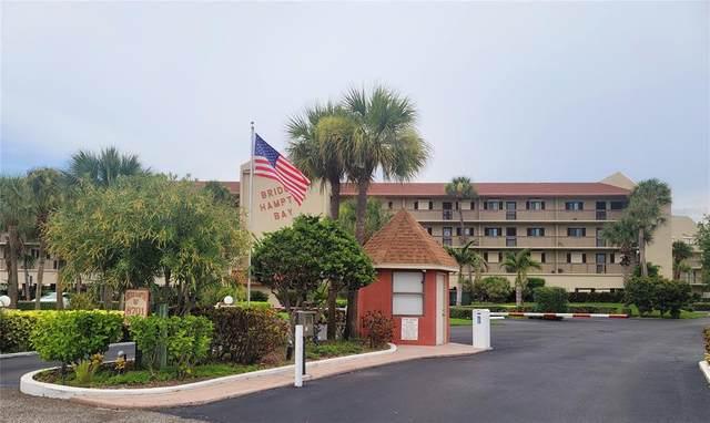 8701 Blind Pass Road 205-B, St Pete Beach, FL 33706 (MLS #U8131629) :: Bob Paulson with Vylla Home