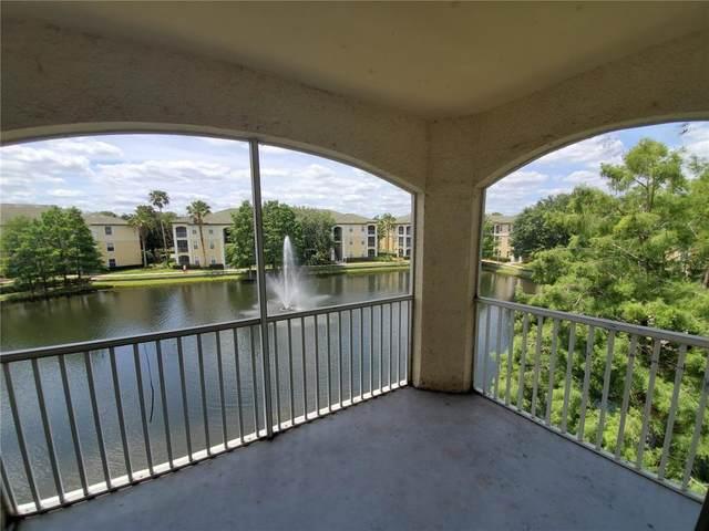 2525 Maitland Crossing Way 13-302, Orlando, FL 32810 (MLS #U8137927) :: Cartwright Realty