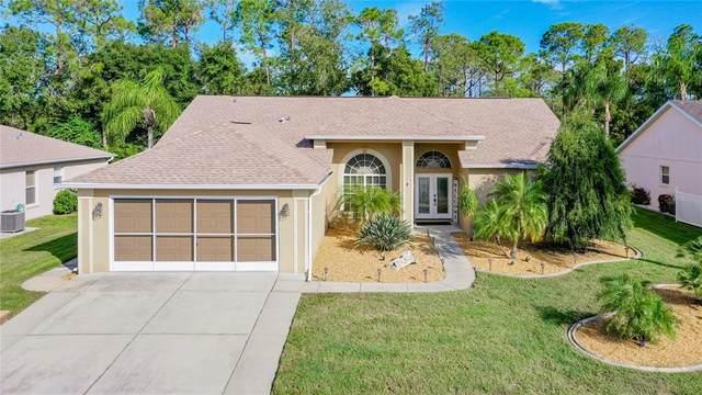 9033 Flagstick Lane, Hudson, FL 34667 (MLS #U8140810) :: Blue Chip International Realty