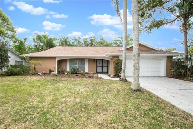 8514 Forest Glade Drive, Bayonet Point, FL 34667 (MLS #W7801213) :: The Duncan Duo Team