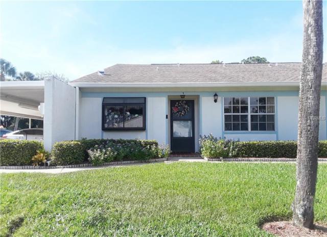 8111 Braddock Circle #1, Port Richey, FL 34668 (MLS #W7804972) :: The Duncan Duo Team