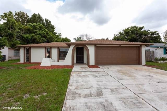 9100 Hunt Club Lane, Port Richey, FL 34668 (MLS #W7815133) :: Dalton Wade Real Estate Group