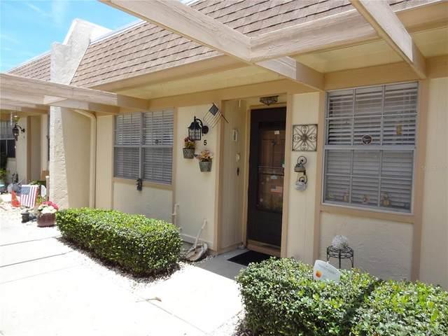 11210 Carriage Hill Drive #5, Port Richey, FL 34668 (MLS #W7835780) :: The Brenda Wade Team