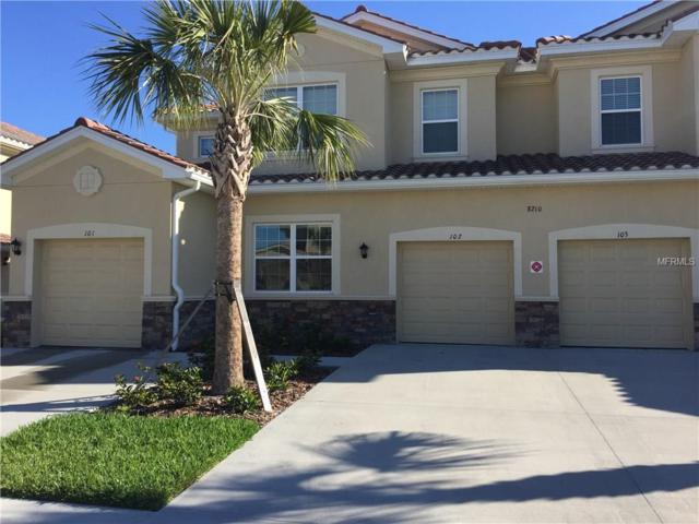 8210 Enclave Way #102, Sarasota, FL 34243 (MLS #A4177429) :: Delgado Home Team at Keller Williams