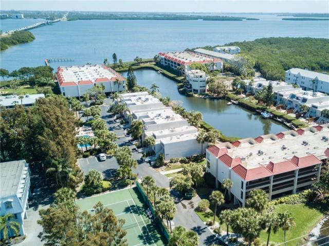 3805 E Bay Drive #204, Holmes Beach, FL 34217 (MLS #A4212320) :: The Duncan Duo Team