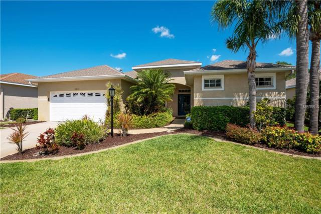 11821 Winding Woods Way, Lakewood Ranch, FL 34202 (MLS #A4400451) :: McConnell and Associates