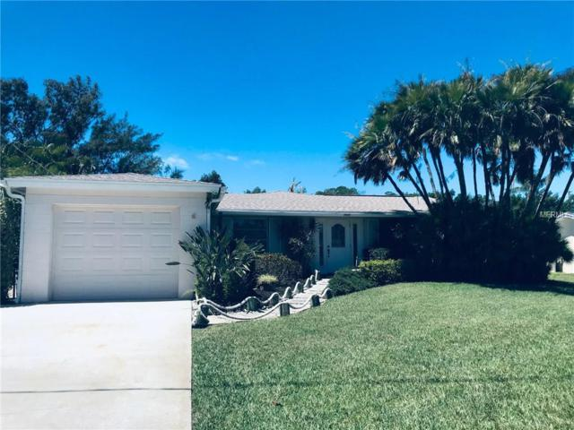 7057 Longboat Drive N, Longboat Key, FL 34228 (MLS #A4433814) :: The Comerford Group