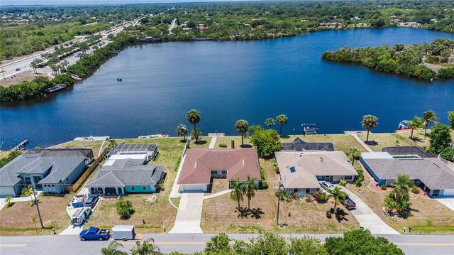 144 Spring Lake Boulevard NW, Port Charlotte, FL 33952 (MLS #C7442785) :: RE/MAX Marketing Specialists