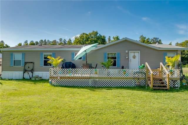 2719 Abilene Trail, Polk City, FL 33868 (MLS #L4910792) :: Cartwright Realty