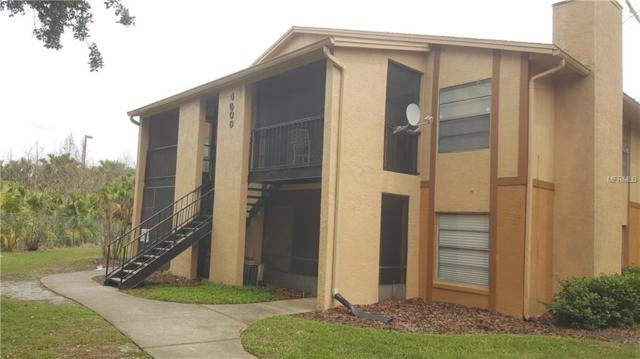4800 S Semoran Boulevard #102, Orlando, FL 32822 (MLS #O5567894) :: Gate Arty & the Group - Keller Williams Realty