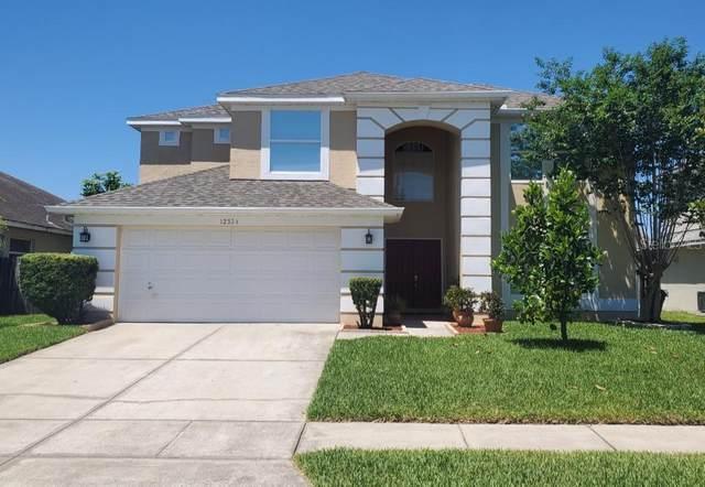 12324 Bronson Way, Orlando, FL 32824 (MLS #O5861130) :: Baird Realty Group