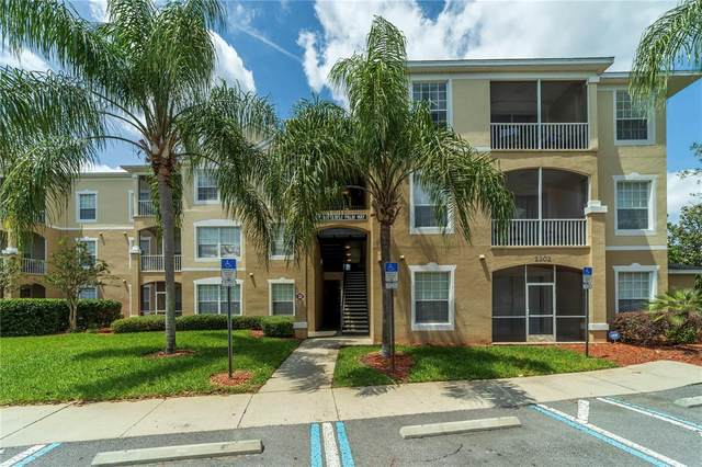 2302 Butterfly Palm Way #202, Kissimmee, FL 34747 (MLS #O5938816) :: Coldwell Banker Vanguard Realty