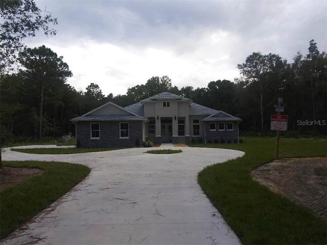 5854 NE 43RD LANE Road, Silver Springs, FL 34488 (MLS #OM608833) :: KELLER WILLIAMS ELITE PARTNERS IV REALTY