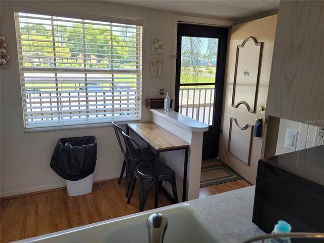 1370 Heather Ridge Boulevard #204, Dunedin, FL 34698 (MLS #OM619331) :: Team Borham at Keller Williams Realty