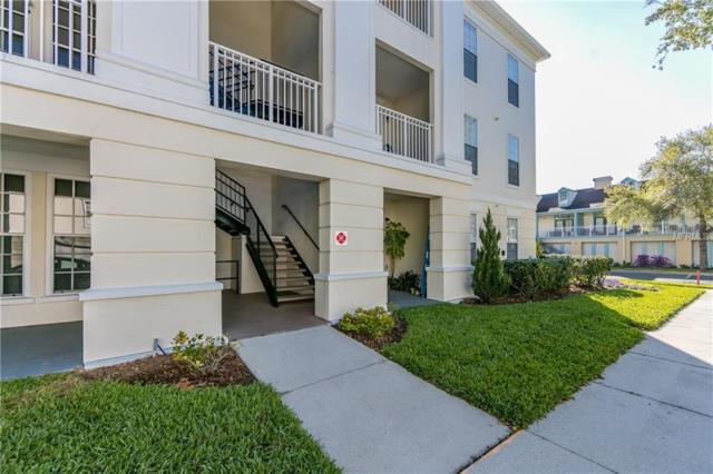 235 Goldenrain Drive #102, Celebration, FL 34747 (MLS #S4850784) :: Five Doors Real Estate - New Tampa