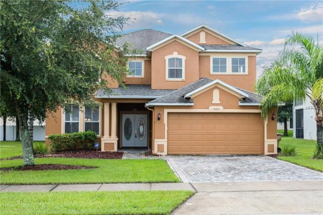 15402 Grand Haven Drive, Clermont, FL 34714 (MLS #S5003713) :: The Duncan Duo Team