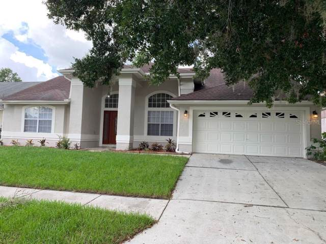 10705 Oak Glen Circle, Orlando, FL 32817 (MLS #S5021863) :: Griffin Group