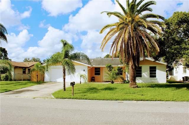 10411 Oleander Drive, Port Richey, FL 34668 (MLS #S5025614) :: The Duncan Duo Team