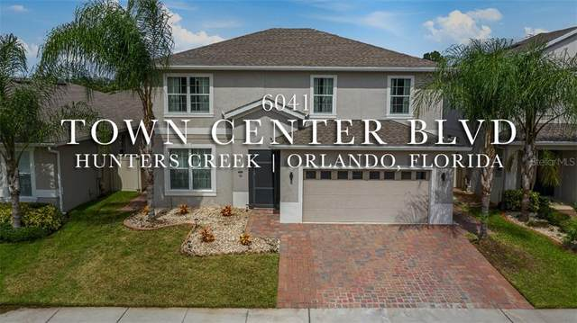 6041 W Town Center Boulevard, Orlando, FL 32837 (MLS #S5040321) :: Key Classic Realty