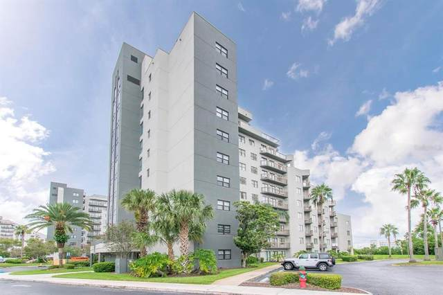 6165 Carrier Drive #2211, Orlando, FL 32819 (MLS #S5056582) :: Visionary Properties Inc