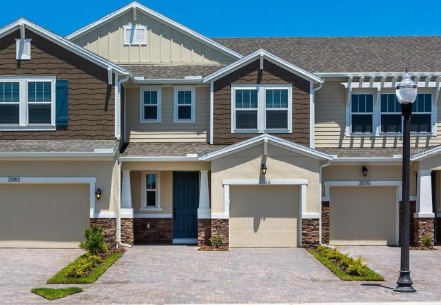 2076 Lake Waters Place #2105, Lutz, FL 33558 (MLS #T2932942) :: The Duncan Duo Team