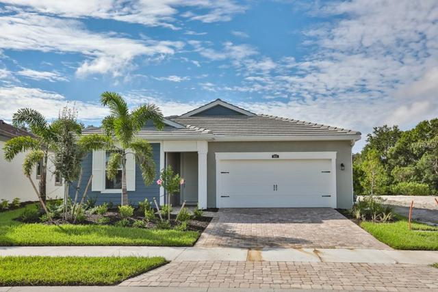 5933 Long Shore Loop #108, Sarasota, FL 34238 (MLS #T3103293) :: The Duncan Duo Team