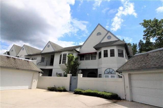 18746 Wimbledon Circle #18746, Lutz, FL 33558 (MLS #T3189245) :: Andrew Cherry & Company