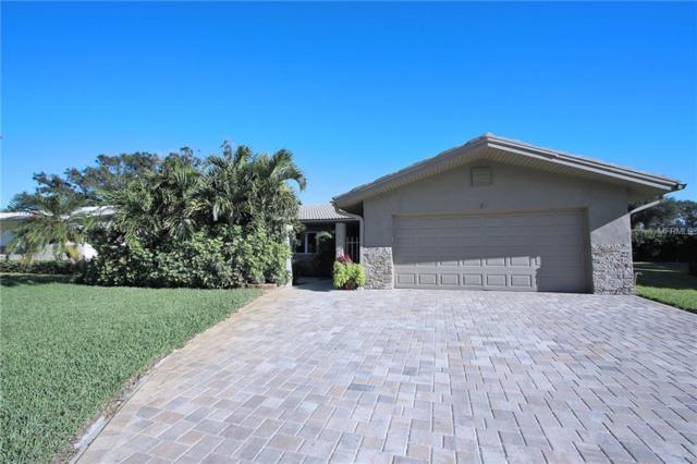 14416 Mooring Drive, Seminole, FL 33776 (MLS #U8024724) :: Remax Alliance