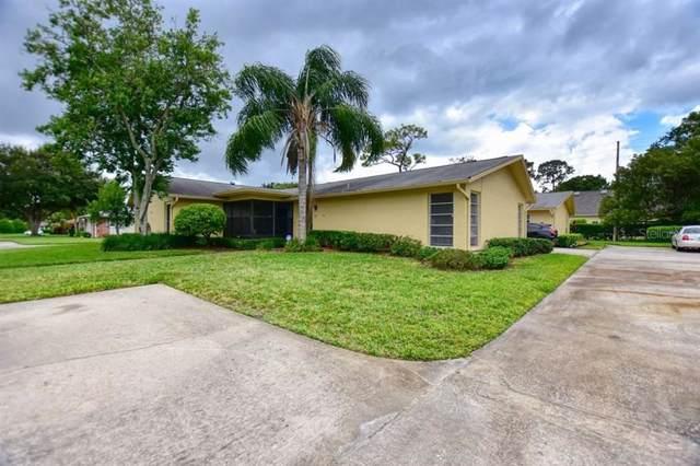 1107 Queen Anne Drive A, Palm Harbor, FL 34684 (MLS #U8060840) :: Delgado Home Team at Keller Williams