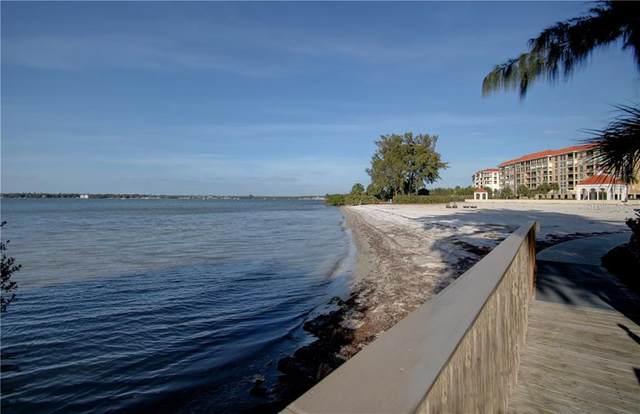 4780 Dolphin Cay Lane S #404, St Petersburg, FL 33711 (MLS #U8071529) :: Zarghami Group