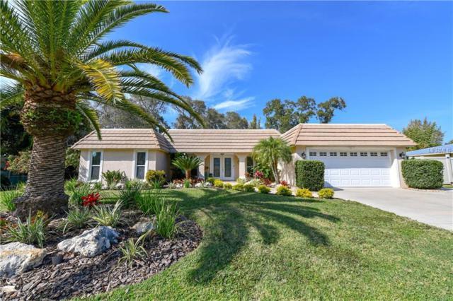 7642 Cove Terrace, Sarasota, FL 34231 (MLS #A4424018) :: The Duncan Duo Team