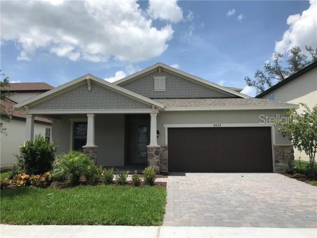 8824 Lake Hall Lane, Oviedo, FL 32765 (MLS #O5773755) :: Premium Properties Real Estate Services