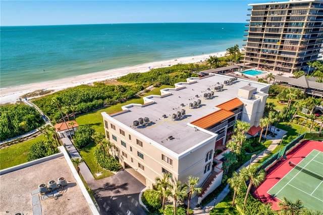 7564 Bayshore Drive #203, Treasure Island, FL 33706 (MLS #U8104773) :: Griffin Group