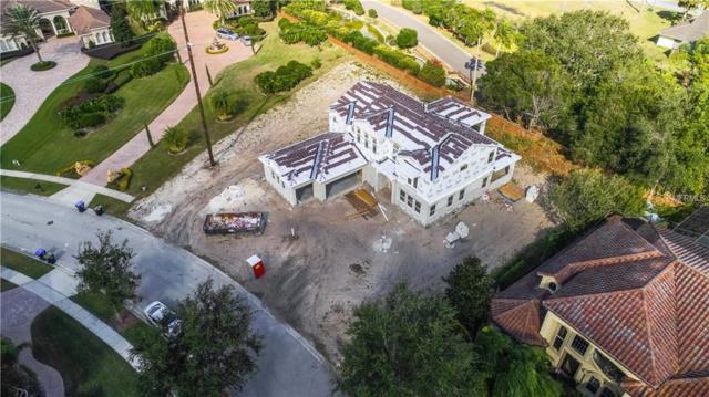 5533 Emerson Pointe Way, Orlando, FL 32819 (MLS #O5550550) :: Godwin Realty Group