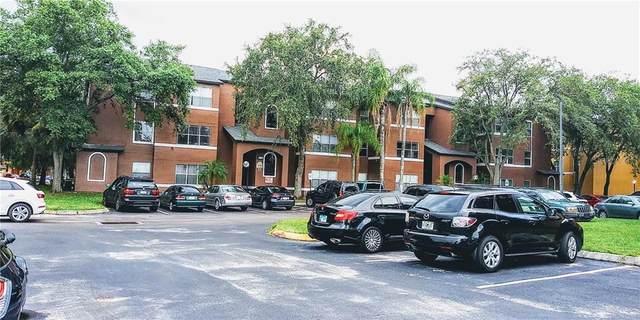 4560 Commander Drive #1322, Orlando, FL 32822 (MLS #S5033734) :: Homepride Realty Services