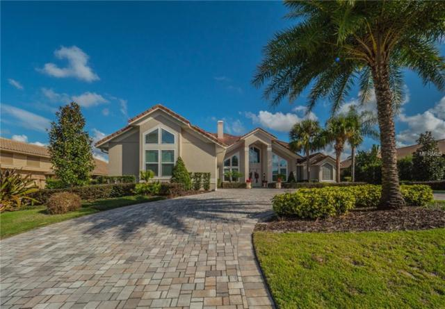 5943 Masters Boulevard, Orlando, FL 32819 (MLS #T2890991) :: RE/MAX Realtec Group